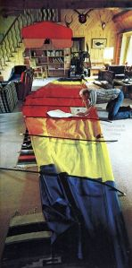 Assembling a powered ultralight in a living room. Photo by Charles O'Rear, 1983, reprinted courtesy Ultralight Flying! magazine.