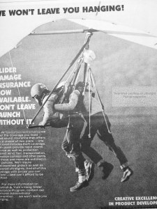 Photo of a dual hang glider launching about 1980