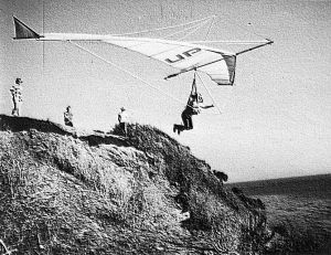 Art based on a photo by Michael Pringle of  Ken DeRussy launching an Ultralight Products Mosquito at Wilcox Beach, Santa Barbara