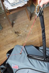 Haul-up chord attached to harness