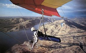 Art based on a photo of Bob Hanes in a 180 Wills Wing Duck and Bill Travers over Millerton Lake on the San Joaquin River