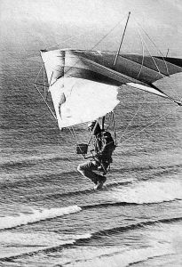 Art based on a photo by Bettina Gray of Jon Lindberg flying an Electra Flyer Olympus at Torrey Pines, San Diego, in 1979