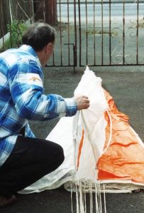 Repacking a hang glider emergency parachute in about 2000