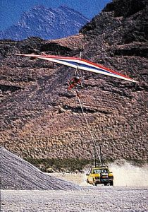 Art based on a photo by Kelvin Jones of Ian Huss of Fly America launching from a desert road via truck tow in 1988