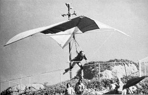 Art based on a photo by Leroy Grannis of a hang glider launching at Torrance Beach, likely in early 1974