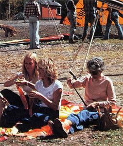 Terri Dunham, Vick iJones, and Katie Grannis attach streamers to tennis balls for pilots to drop at Telluride. Photo by Leroy Grannis.