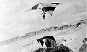 Eddie Paul in the Whitney Enterprises PortaWing hang glider at Torrance Beach, early 1970s