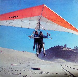 Toni-Junell Herbert and Robert Millman in a hang glider at Cape Kiwanda, Orgegon. Photo by Skip Brown.