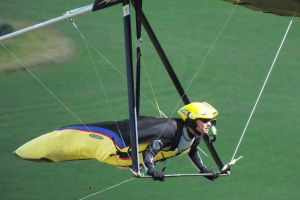 Close-up of hang glider pilot flying at Mere, Wiltshire, England, in June 2020
