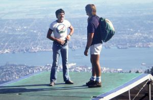 Barry Batman and another hang glider pilot converse on the launch ramp at Grouse Mountain in 1984. Photo by Jan Kulhavy.