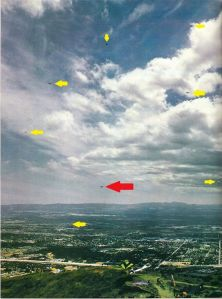 Eight hang gliders in the air in 1974 with arrows overlaid