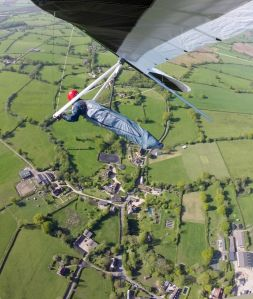 Wills Wing U-2 hang glider over a village in north Dorset in 2015