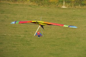 Gary Dear flying a Hiway Scorpion 2 hang glider at Monk's Down, north Dorset, England, in 2018