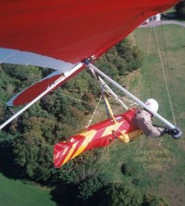 Hang glider setting up for a landing near the mansion below Kimmeridge, Dorset, England, in 2005