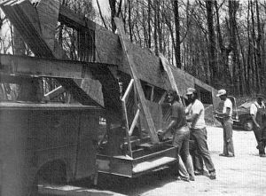 Curved trusses arrive at Henson's Gap, Tennessee, to construct a hang glider launch ramp in 1982