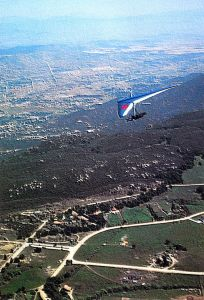 Mitch McAleer flying a hang glider at Elsinore, California. Photo by Dave Freund.