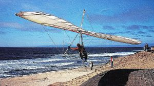 Steve Morris launching in a hang glider at Marina Beach, California. Photo by Geoff Phipps.