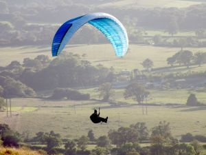Paraglider in flight at Bell Hill, north Dorset, England, in August 2014