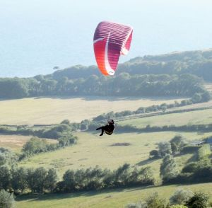 Paraglider in evening lift at Ringstead, July 2015