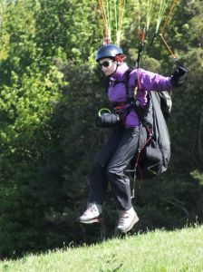 Paraglider pilot launching at Monk's Down, Dorset, England, in 2016