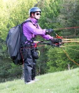 Paraglider pilot preparing to launch at Monk's Down, Dorset, England, in 2016