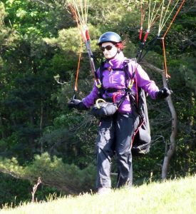 Paraglider pilot readying to launch at Monk's Down, Dorset, England, in 2016
