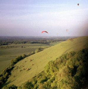 Paragliders and a balloon at Combe Gibbet, Berkshire, England, in May or June, 2004
