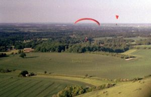 Combe Gibbet, Berkshire, England, in June 2004 taken with a hand-held compact 35mm film camera aboard a paraglider