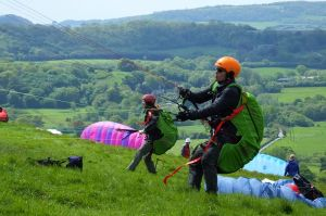 New paraglider pilots undergoing training at Bell Hill, Dorset, England, in 2018