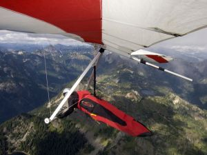 Novelist Vaughn Entwistle flying a hang glider at Rampart Ridge in the Cascades