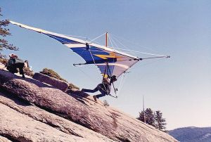 Eves Tall Chief launches an Eipper Antares hang glider at Yosemite