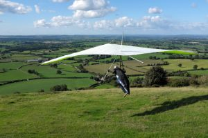 Tony Woodley launches in an Avian Rio hang glider at Bell Hill, north Dorset, UK