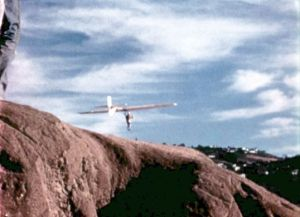 Volmer Jensen in his VJ-23 rigid hang glider beyond the bluffs, Torrance Beach, in 1973