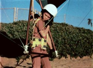 Hall Brock, age 10, adjusts his helmet before launching in a hang glider at Torrance Beach in 1973