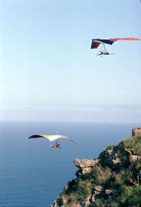 Michael Van Dorn in an Eipper Cumulus V above another hang glider at Makapuu, Hawaii, in January 1978