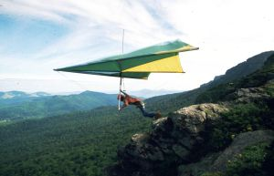 Standard Rogallo hang glider launching from Grandfather Mountain