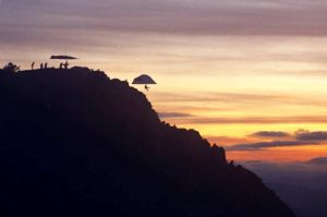 Hang gliders launching at sunset from Grandfather Mountain