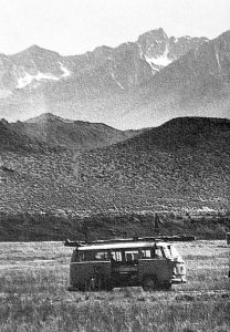 VW bus with hang glider on the roof in the Owens Valley