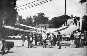 A section of two Pterodactyl powered ultralights refuels at a roadside gasoline station